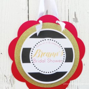 black gold red bridal shower door sign